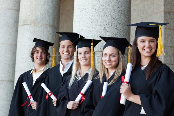 Uśmiechnięty absolwenci stwarzające line kolumny dziewczyna Zdjęcia stock © wavebreak_media