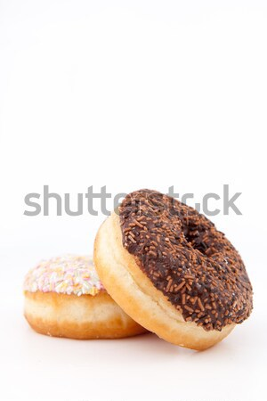 Muffins piled up with icing sugar against a white background Stock photo © wavebreak_media