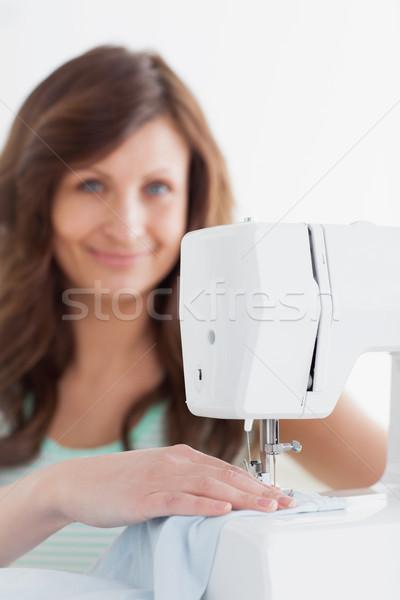 Kadın dikiş makinesi beyaz mutlu makine kadın Stok fotoğraf © wavebreak_media