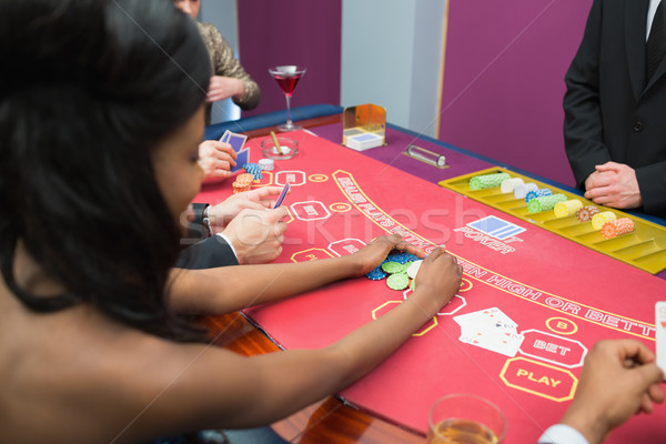 Woman winning at poker in casino Stock photo © wavebreak_media