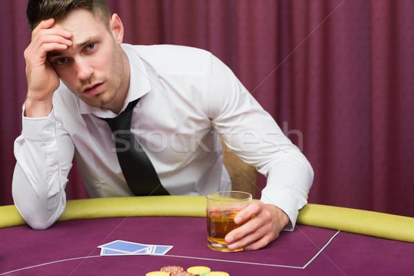 Adam poker tablo içme viski Stok fotoğraf © wavebreak_media
