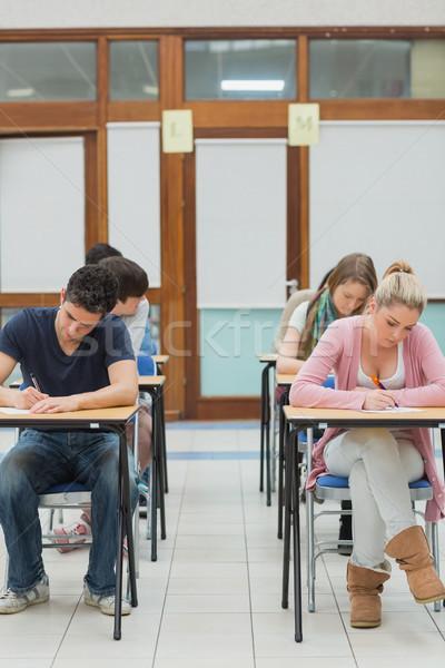 Diákok ül vizsga főiskola munka toll Stock fotó © wavebreak_media