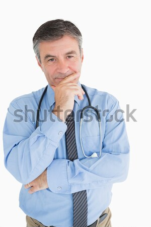 Smiling doctor with hand on chin is thinking Stock photo © wavebreak_media
