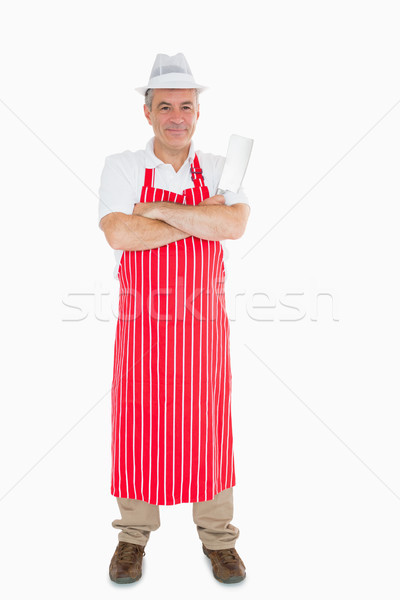 Smiling butcher in apron with meat cleaver and crossed arms Stock photo © wavebreak_media