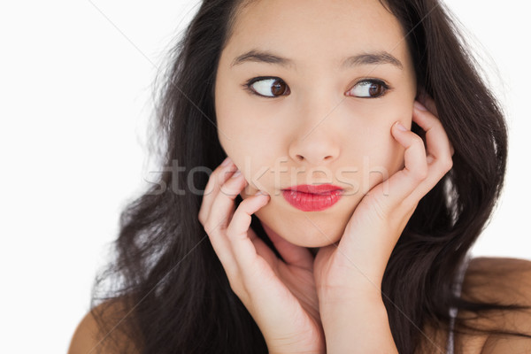Woman looking afraid against white background Stock photo © wavebreak_media