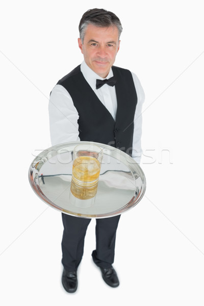 Waiter in suit serving whiskey with ice on silver tray Stock photo © wavebreak_media
