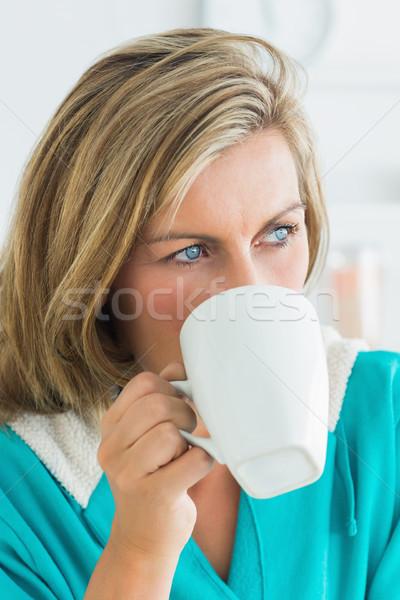 Kadın bornoz içme kahve mutlu Stok fotoğraf © wavebreak_media