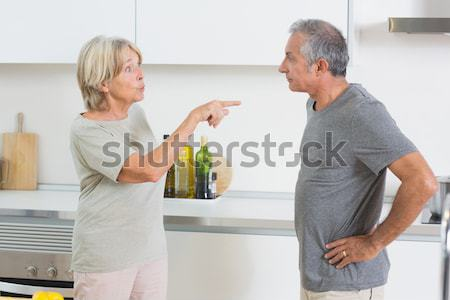Smiling woman holding the hand of a patient in a room Stock photo © wavebreak_media