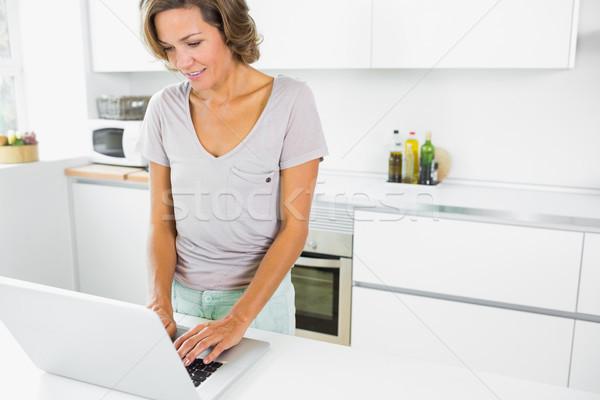 Happy woman using laptop Stock photo © wavebreak_media