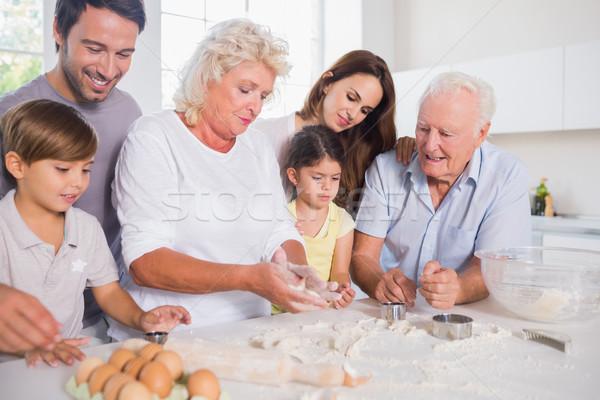 счастливая семья вместе кухне женщину семьи Сток-фото © wavebreak_media