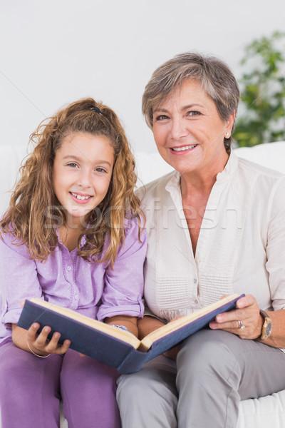 Kislány nagymama néz kamera könyv ül Stock fotó © wavebreak_media
