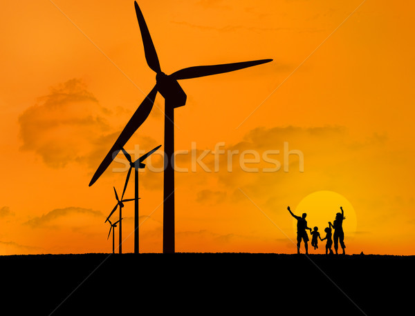 Wind turbines and family with a sunset Stock photo © wavebreak_media