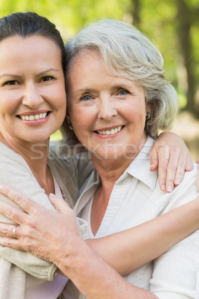 Smiling mature woman with adult daughter Stock photo © wavebreak_media