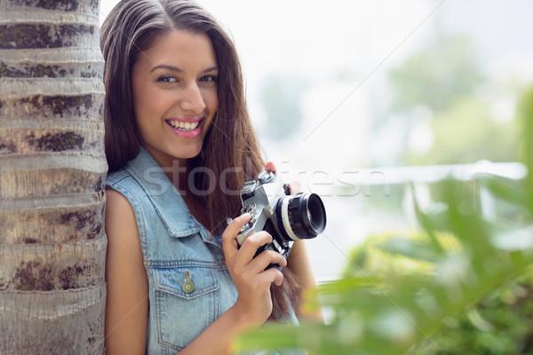 şık genç fotoğrafçı gülen kamera Stok fotoğraf © wavebreak_media