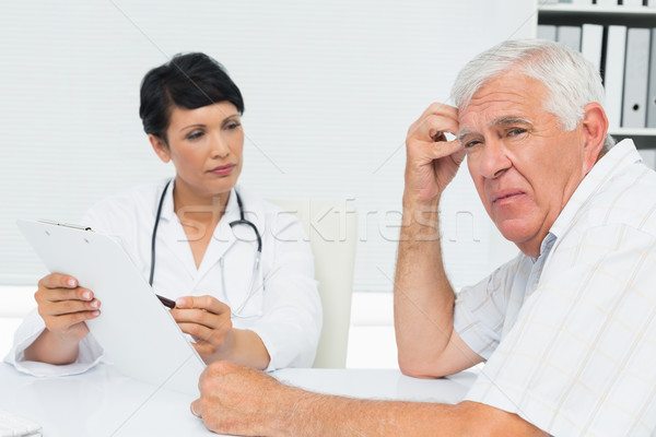 Doctor showing reports to worried senior patient Stock photo © wavebreak_media