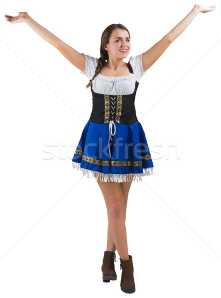 Pretty oktoberfest girl smiling with arms raised Stock photo © wavebreak_media
