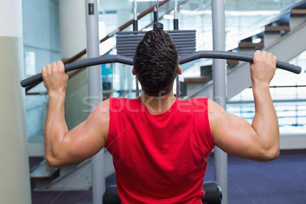 Sterke bodybuilder gewicht machine armen gymnasium Stockfoto © wavebreak_media
