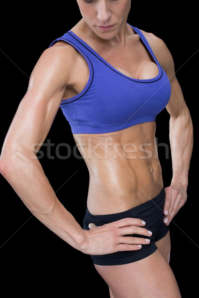 Strong woman posing in sports bra and shorts Stock photo © wavebreak_media