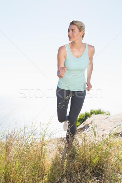 Fitt szőke nő jogging hegy nyom napos idő Stock fotó © wavebreak_media