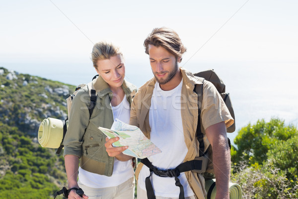 Hiking couple reading map at mountain summit Stock photo © wavebreak_media