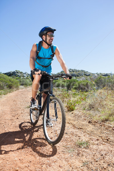 Fit cyclist riding in the countryside Stock photo © wavebreak_media