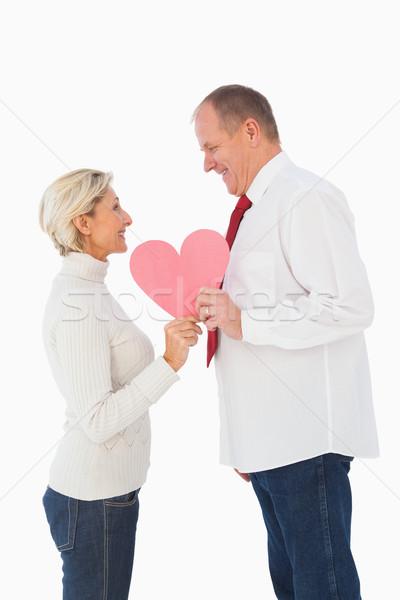 Older affectionate couple holding pink heart shape Stock photo © wavebreak_media