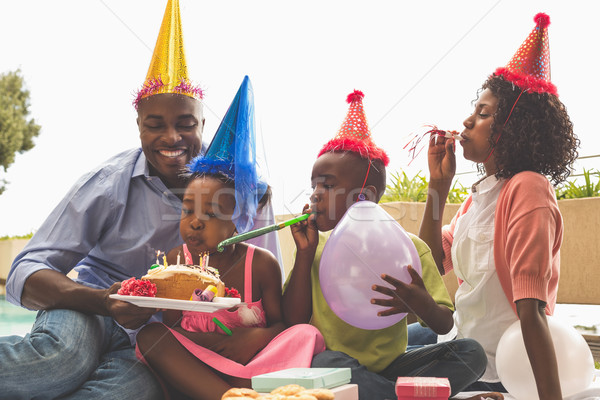 Happy family celebrating a birthday together in the garden Stock photo © wavebreak_media