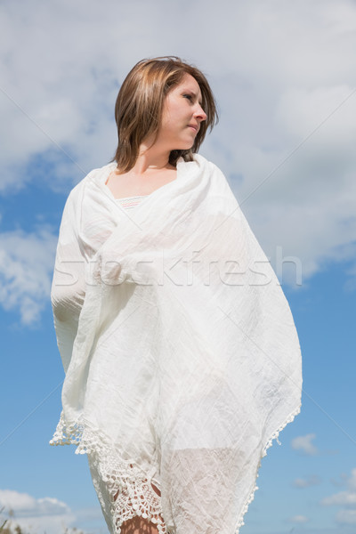 Woman looking away against blue sky and clouds Stock photo © wavebreak_media