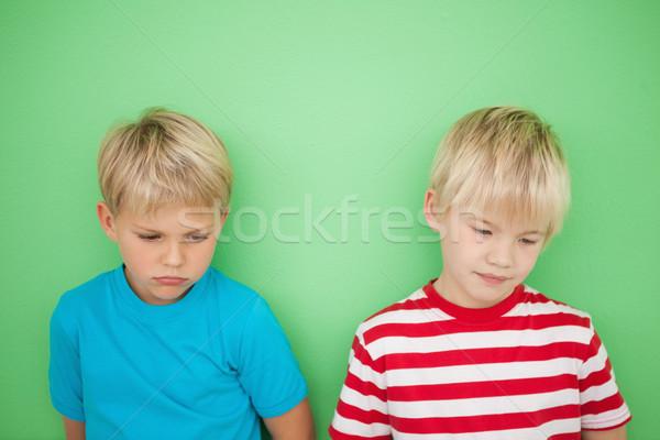 Stock photo: Sad little boys looking down