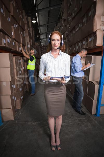 Warehouse manager smiling at camera Stock photo © wavebreak_media