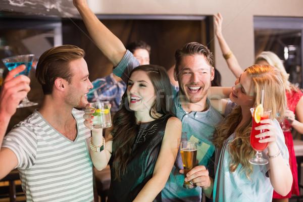 Fiatal barátok ital együtt bár tánc Stock fotó © wavebreak_media