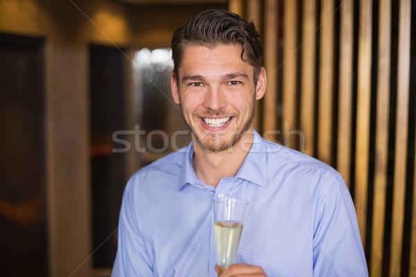Hombre guapo flauta champán bar beber Foto stock © wavebreak_media
