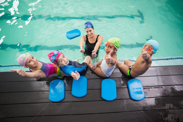 Cute natation classe coach souriant loisirs Photo stock © wavebreak_media