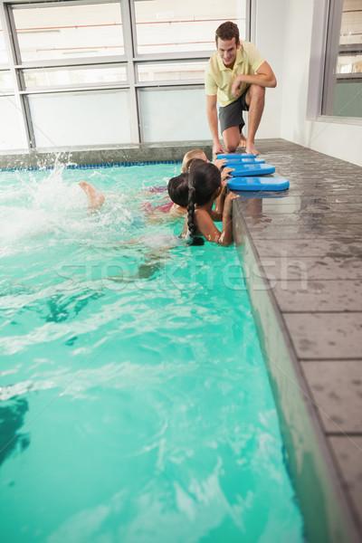 Sevimli yüzme sınıf dinleme koç boş Stok fotoğraf © wavebreak_media