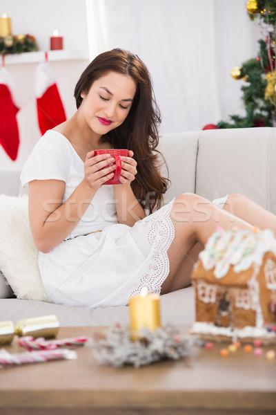 Nyugodt barna hajú tart bögre forró ital karácsony Stock fotó © wavebreak_media