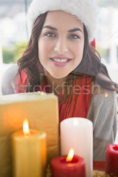 Portrait of pretty brunette behind candles Stock photo © wavebreak_media