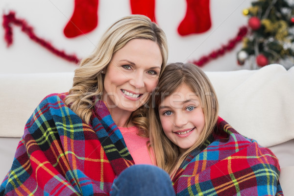 Festive mother and daughter wrapped in blanket Stock photo © wavebreak_media