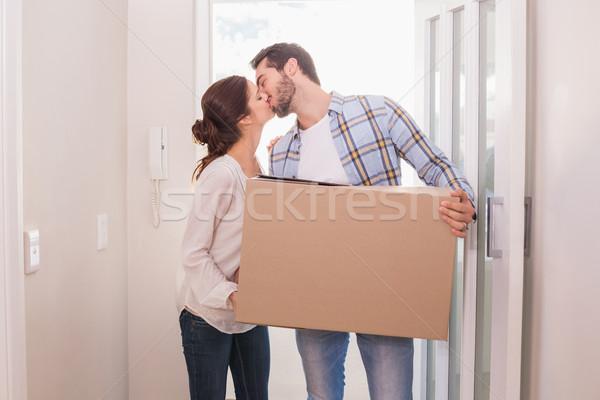 Cute couple carrying cardboard box Stock photo © wavebreak_media