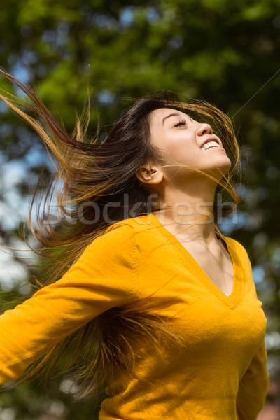 Beautiful woman with arms outstretched in park Stock photo © wavebreak_media