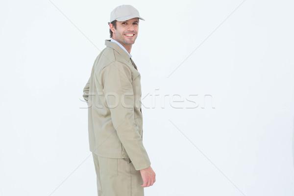 Vista lateral retrato feliz mensajero pie blanco Foto stock © wavebreak_media