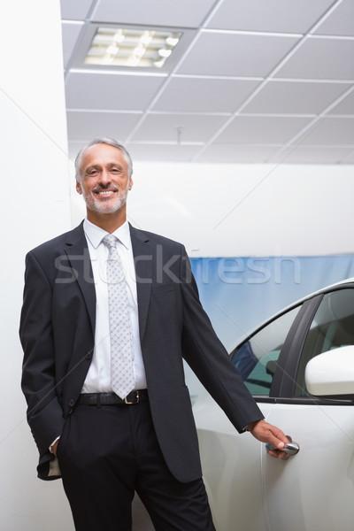 Mosolyog üzletember tart autó ajtó új autó Stock fotó © wavebreak_media