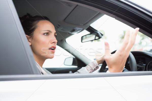 Pretty businesswoman experiencing road rage Stock photo © wavebreak_media