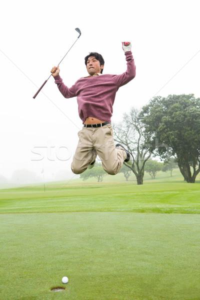 Excitado golfista saltar hasta campo de golf deporte Foto stock © wavebreak_media
