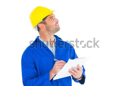 Male supervisor looking up while writing on clipboard Stock photo © wavebreak_media