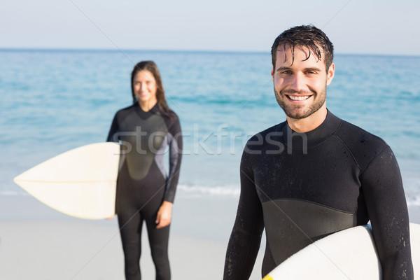 Boldog pár szörfdeszka napos idő tengerpart férfi Stock fotó © wavebreak_media