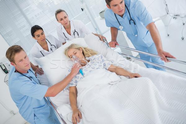 Team of doctors carrying patient on stretcher Stock photo © wavebreak_media