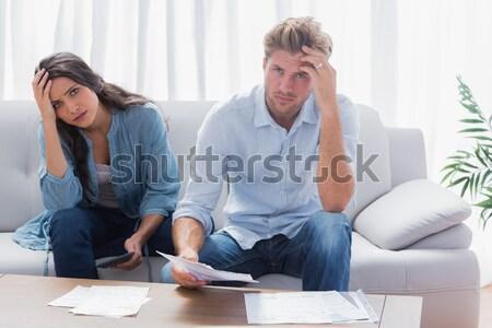 Unhappy couple are stern and having troubles Stock photo © wavebreak_media