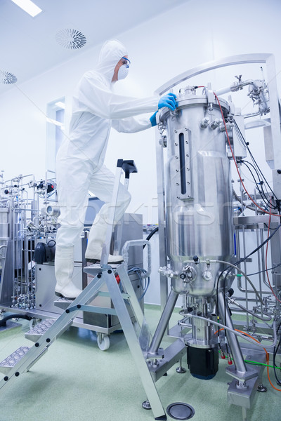 Scientist in protective suit standing on ladder Stock photo © wavebreak_media