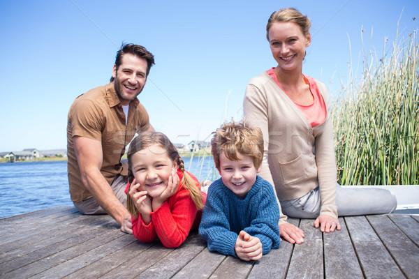 Happy family at a lake Stock photo © wavebreak_media
