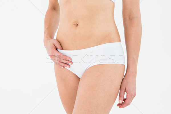 Fit woman suffering from stomach pain  Stock photo © wavebreak_media